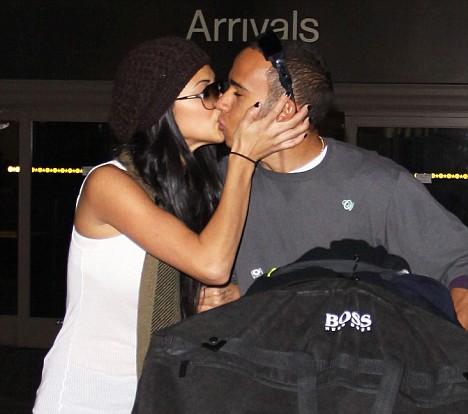 Lewis Hamilton and Nicole Scherzinger share a romantic kiss