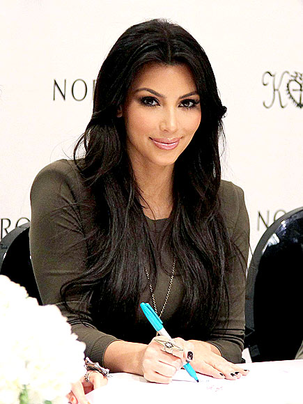 Sweet Kim Kardashian Promotes Virgins Saints and Angels jewelry Line